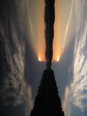 A sunset at Pennyfield Lock turns into an fiery torch with the help of the photo editor's rotate right button.